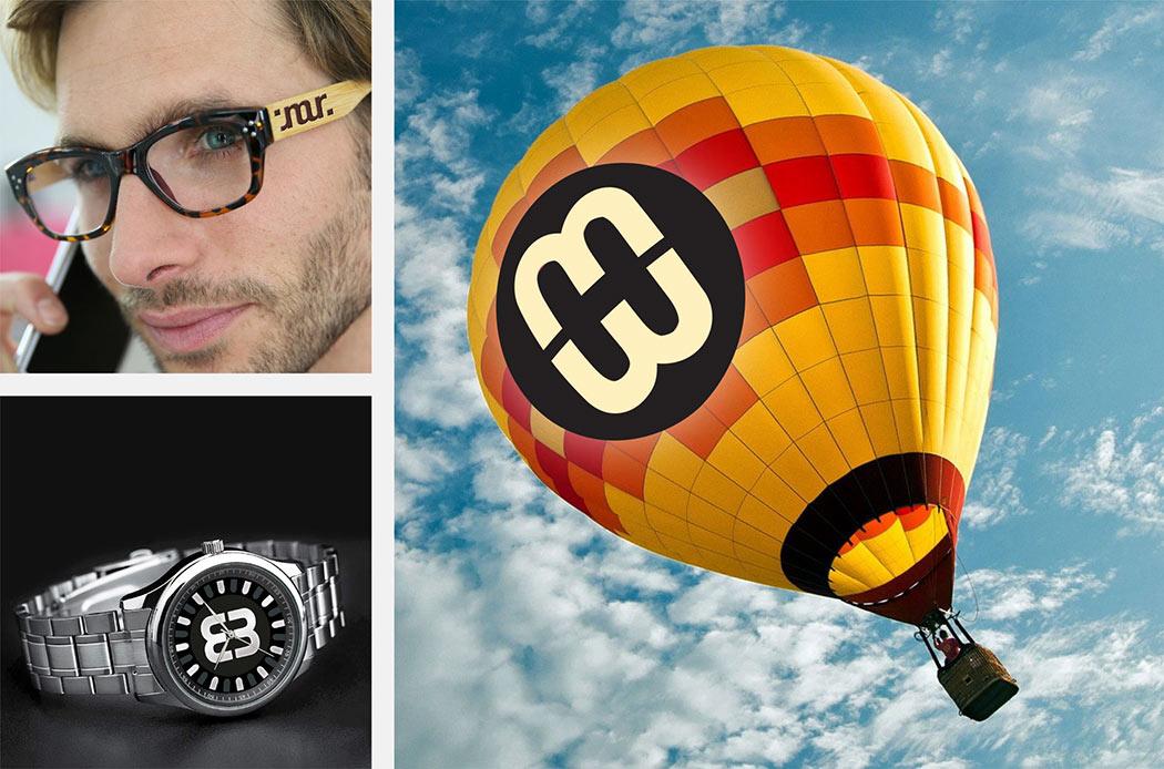 Ambigramme auf Brille, Zifferblatt einer Uhr, Heißluftballon, luxuriös, gestaltet von Roland Scheil, Grafiker